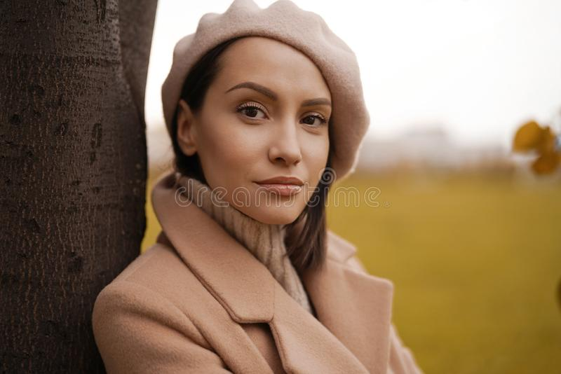 Beautiful lady in autumn landscape royalty free stock image