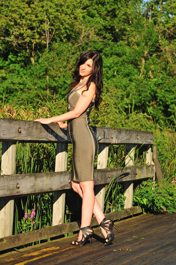 Outdoor fashion portrait of exotic brunette woman royalty free stock photos
