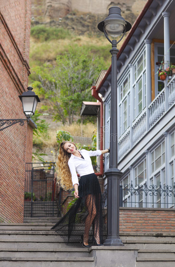 Outdoor fashion portrait of glamour sensual young stylish lady royalty free stock photography