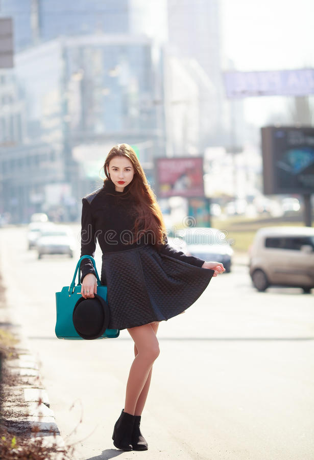Outdoor fashion portrait of glamour sensual young stylish lady wearing trendy fall outfit , black hat. Outdoor fashion portrait of glamour sensual young stylish royalty free stock photo