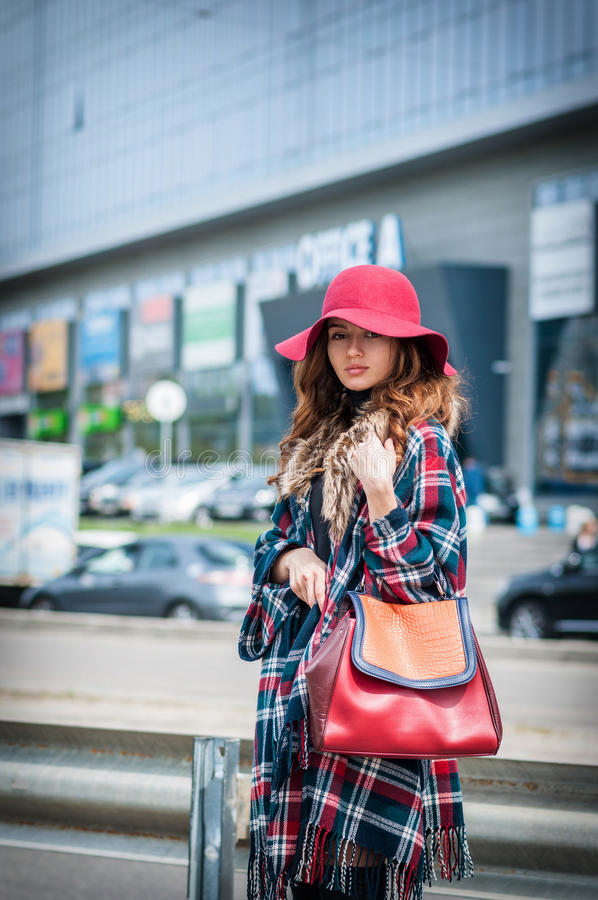 Outdoor fashion portrait of glamour sensual young stylish lady wearing trendy fall outfit , hat ,and leather bag stock images