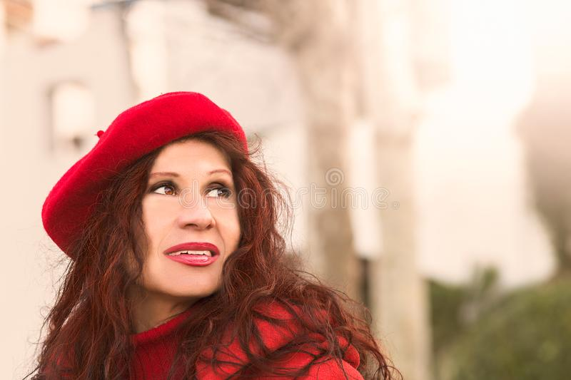 Outdoor fashion portrait of mature woman royalty free stock photo
