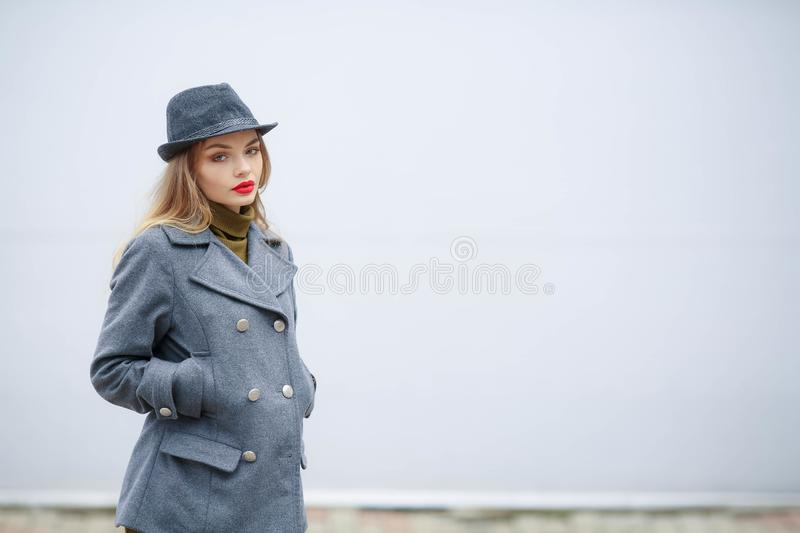 Outdoor fashion portrait of young beautiful fashionable woman wearing stylish accessories.vintage hat,looking at camera royalty free stock photos