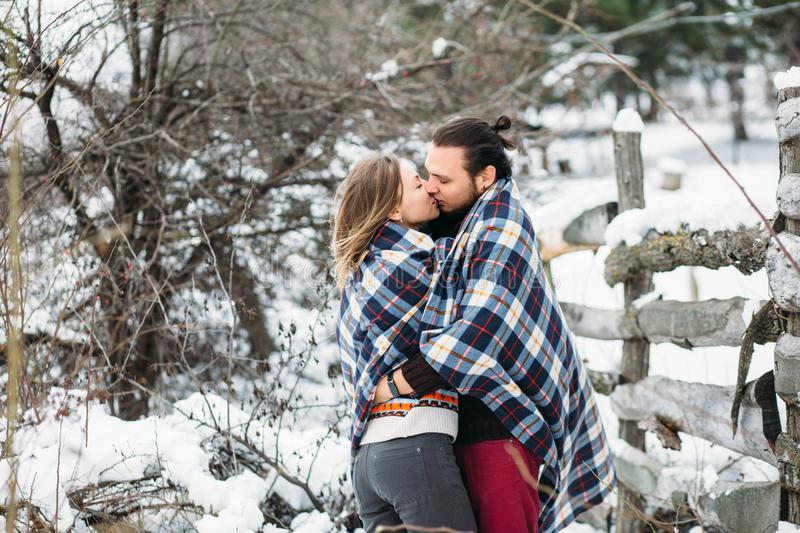 Outdoor fashion portrait of young sensual couple in cold winter weather. love and kiss. Outdoor fashion portrait of young sensual couple in cold winter wather royalty free stock images