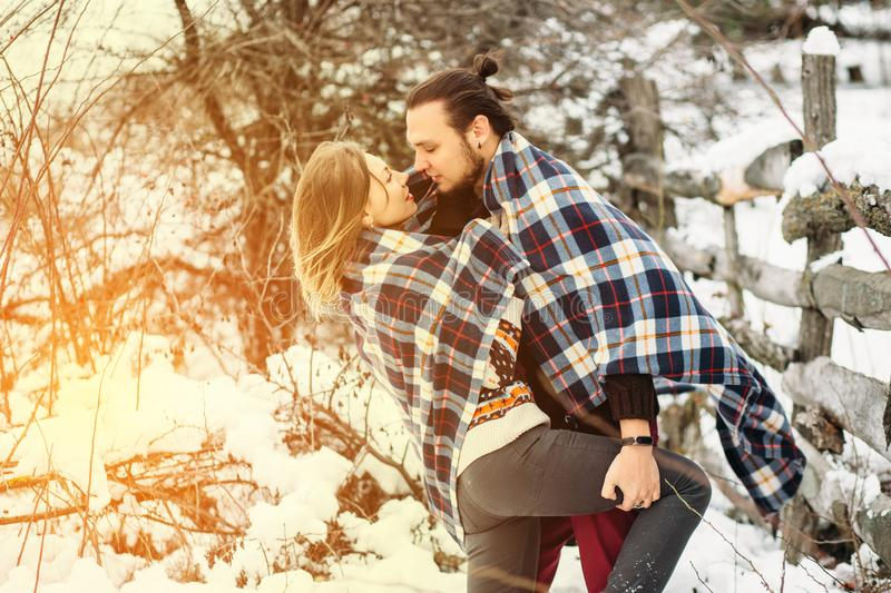 Outdoor fashion portrait of young sensual couple in cold winter weather. love and kiss royalty free stock images