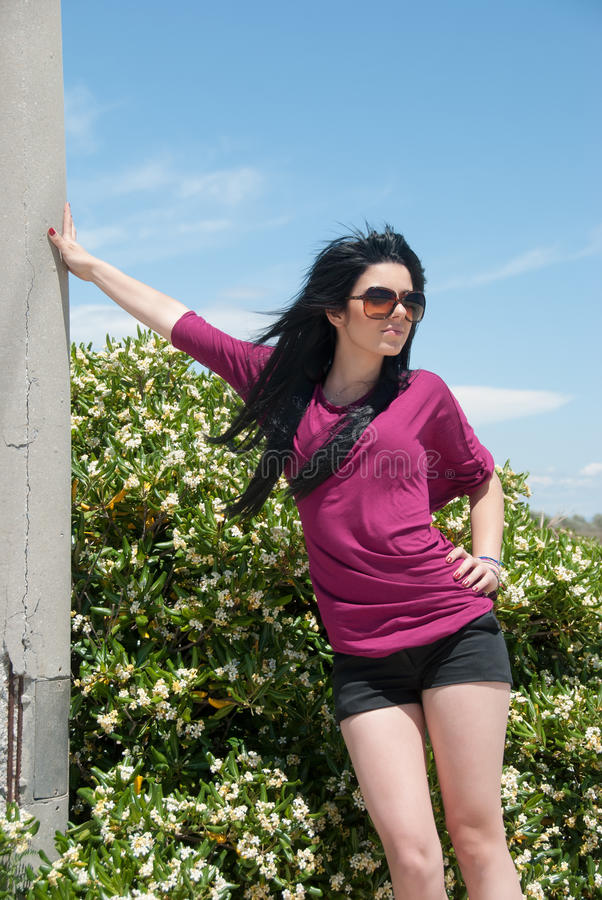 Outdoor of a fashion teen with shorts and sunglasses stock photos