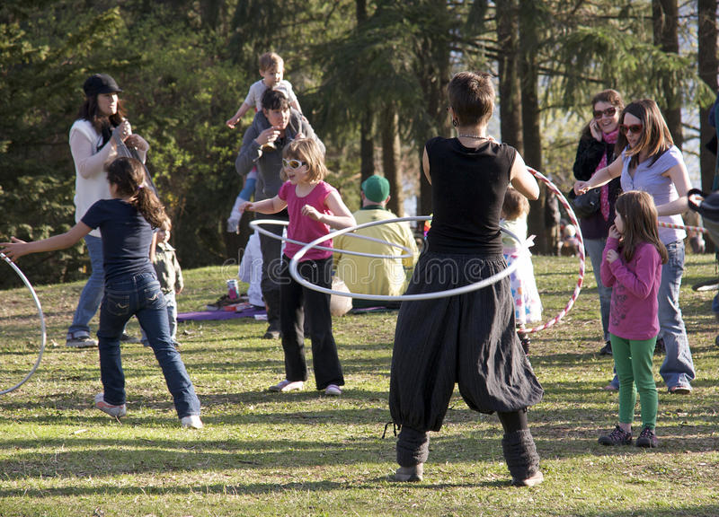 Outdoor Festival - High Park, Toronto Canada. Girls get a lesson on using a hoola hoop during the Cherry Blossom Festival in High Park - Toronto stock photo
