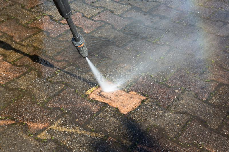 Outdoor floor clean driveway with pressure water jet. An Outdoor floor clean driveway with pressure water jet stock photography