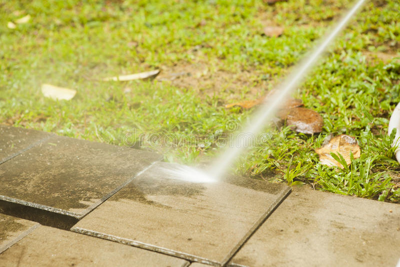 Outdoor floor cleaning with high pressure water jet stock photography