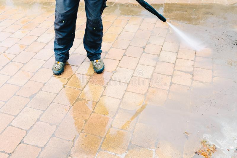 Outdoor floor cleaning with high pressure water jet - cleaning c stock image