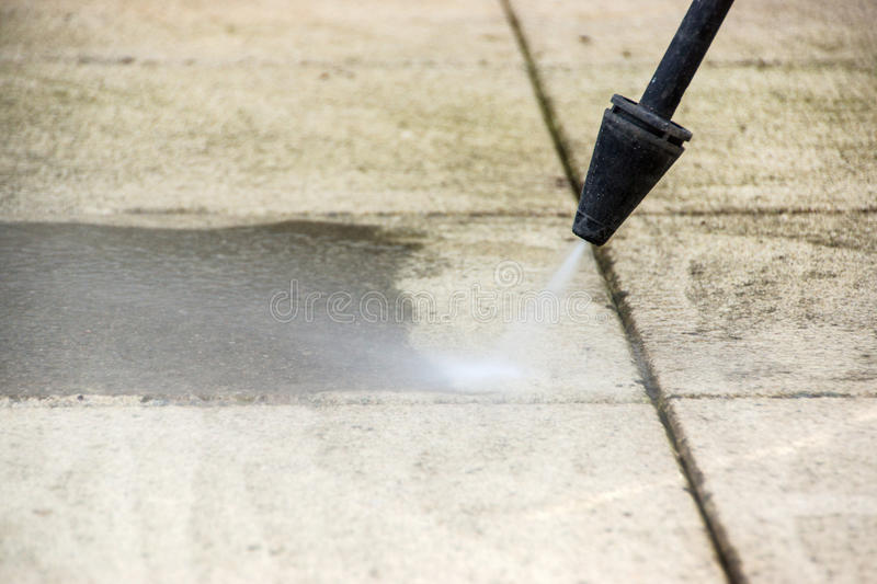 Outdoor floor cleaning with high pressure water jet stock photo