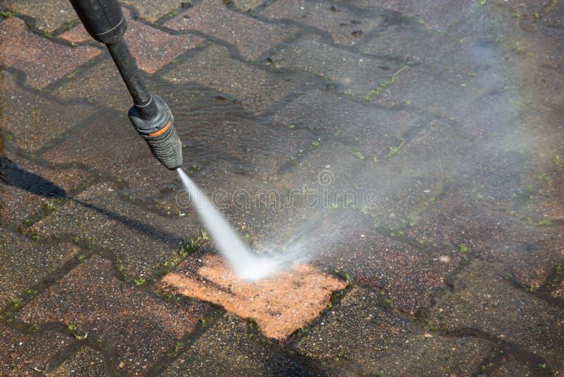 Outdoor floor sidewalk deep cleaning with high pressure water jet. An Outdoor floor sidewalk deep cleaning with high pressure water jet royalty free stock photo