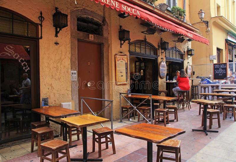 Outdoor french traditional outdoor cafe , Nice, France. stock photos