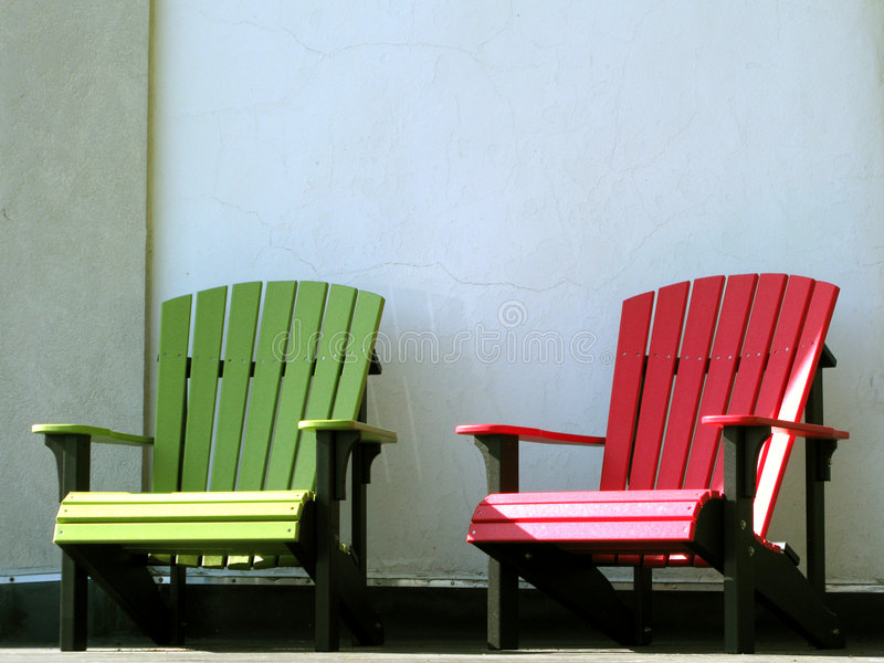 Outdoor Furniture Adirondack Chairs on House Porch stock images