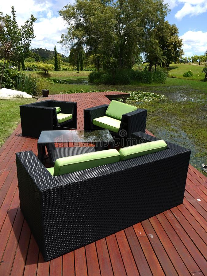 Outdoor furniture: chairs on garden platform - v royalty free stock images