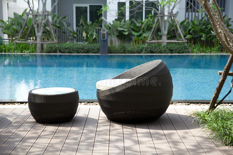 Outdoor furniture rattan chairs stock images
