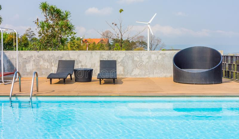 Outdoor furnitures and swimming pool. Facilities for recreation and relaxation royalty free stock photo