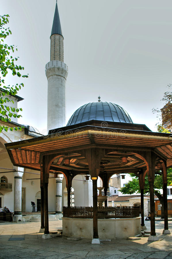 Outdoor gazebo. In courtyard with breezeway and spire of adjacent building stock photography