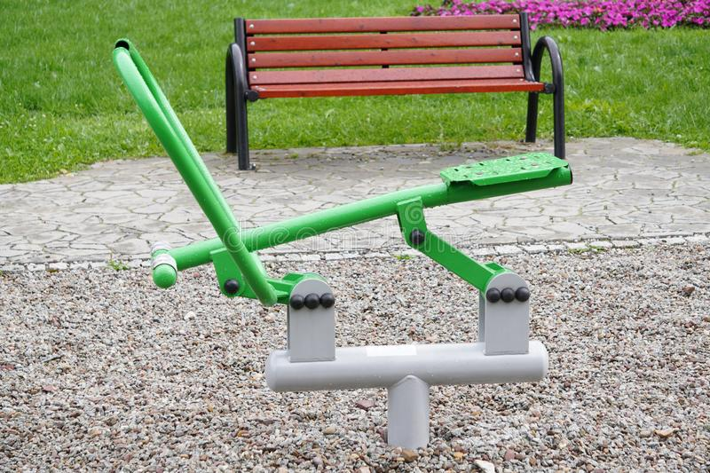 Outdoor green-gray iron exercise machine for sports. public gym, muscle building, exercise. The outdoor green-gray iron exercise machine for sports. public gym royalty free stock photo