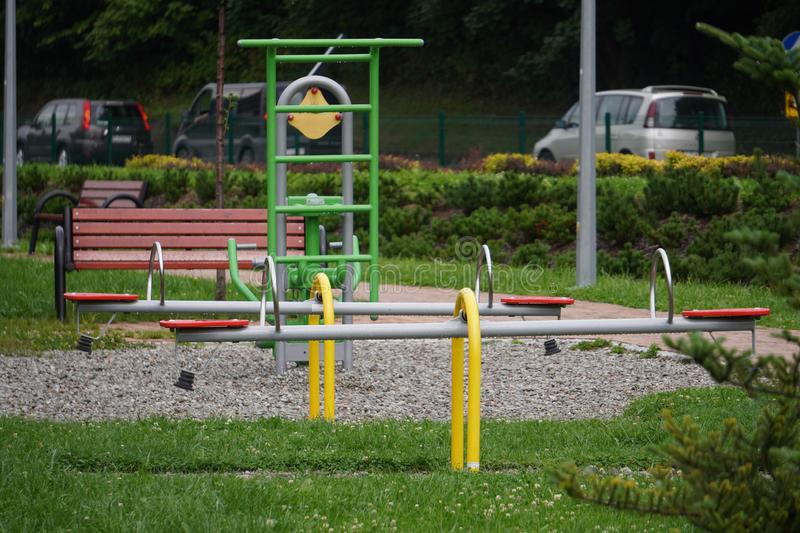 Outdoor green-gray iron exercise machine for sports. public gym, muscle building, exercise. The outdoor green-gray iron exercise machine for sports. public gym stock images