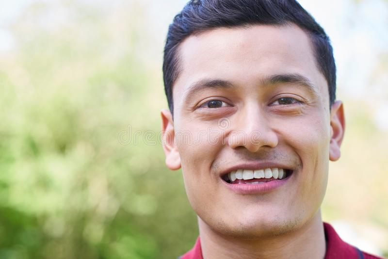 Outdoor Head And Shoulders Portrait Of Smiling Young Man stock photos