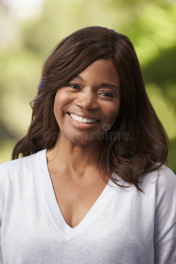Outdoor Head And Shoulders Portrait Of Woman stock photos