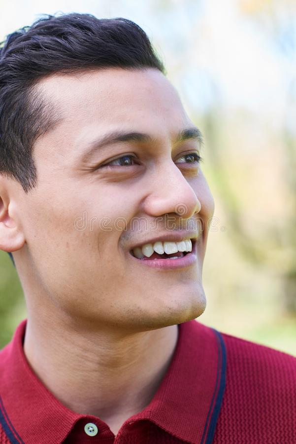 Outdoor Head And Shoulders Portrait Of Smiling Young Man stock images