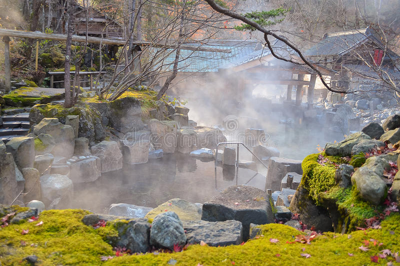 Outdoor hot spring, Onsen in japan in Autumn royalty free stock photo