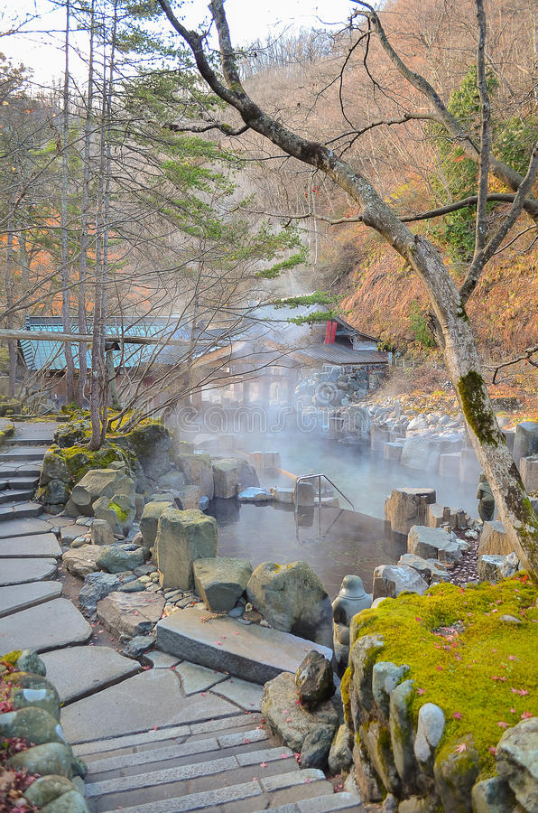 Outdoor hot spring with stone walk path, Onsen in japan royalty free stock photos