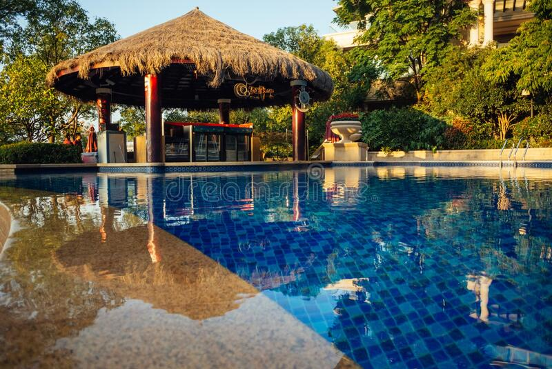 Outdoor hotel swimming pool royalty free stock photos
