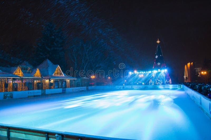 Outdoor ice skating rink and Christmas tree in Pyatigorsk (Russia). Pyatigorsk, Russia - December 31, 2014: View of the outdoor ice skating rink and Christmas royalty free stock photo