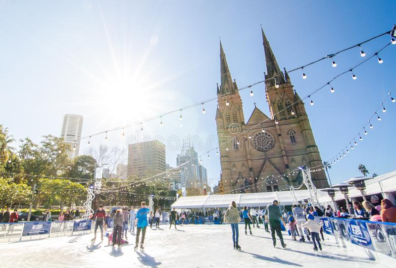 Outdoor ice skating rink at St Mary's Cathedral Square in winter season with sunshine day. SYDNEY, AUSTRALIA. – On July 9, 2017. - Outdoor ice stock photo