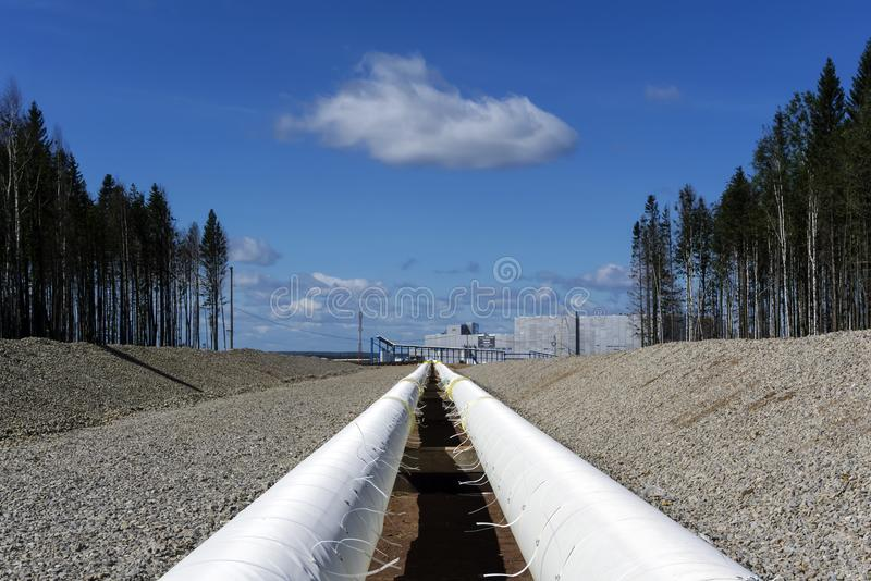 Outdoor industrial pipeline. New industrial pipeline with thermal insulation leading to an industrial enterprise, in the open air stock photos