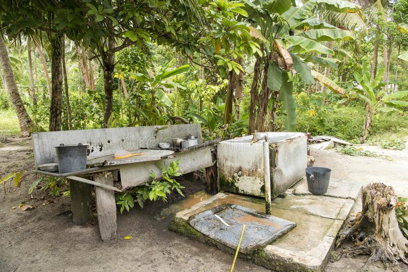 Outdoor kitchen at the edge of rainforest stock images