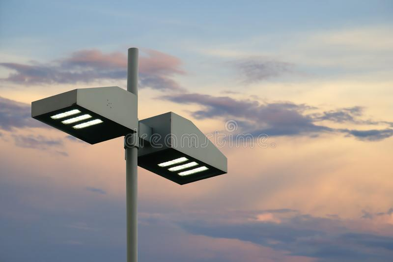Outdoor Lamp Post with LED Lights on Evening Sky Background. Modern Style Outdoor Lamp Post with LED Lights on Evening Sky Background royalty free stock photos
