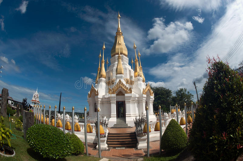 Outdoor large Pagoda in Buddhist temple Wat Tham Khuha Sawan. Outdoor large Pagoda in Buddhism temple Wat Tham Khuha Sawan temple is located on a high cliff royalty free stock photography