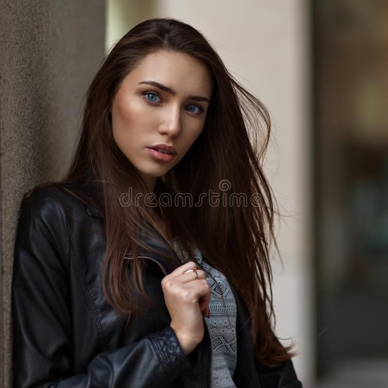 Outdoor lifestyle fashion portrait of pretty young girl, wearing in hipster swag grunge style on urban background. Retro vintage royalty free stock photography