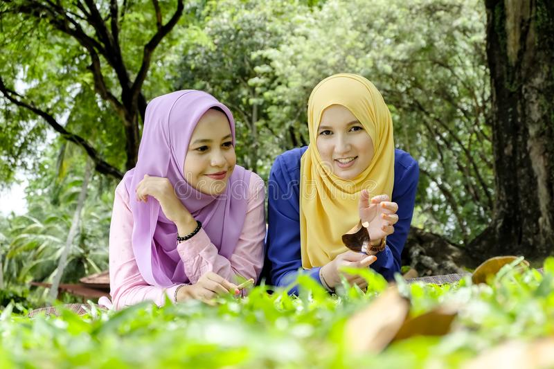 Outdoor lifestyle, friendship and happiness concept. portrait of smile young women at park royalty free stock images
