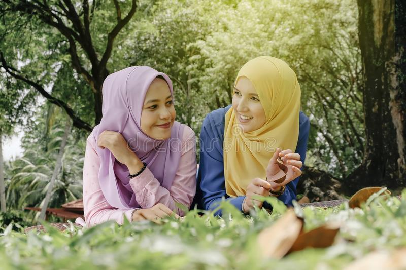 Outdoor lifestyle, friendship and happiness concept. portrait of smile young women at park stock image