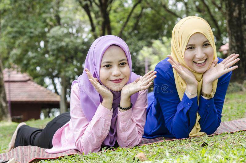 Outdoor lifestyle, friendship and happiness concept. portrait of smile young women at park royalty free stock photos