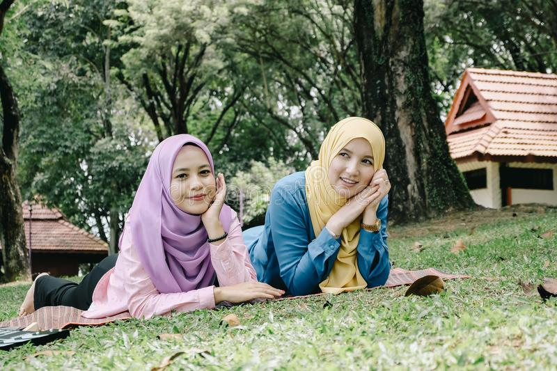 Outdoor lifestyle, friendship and happiness concept. portrait of smile young women at park stock photo