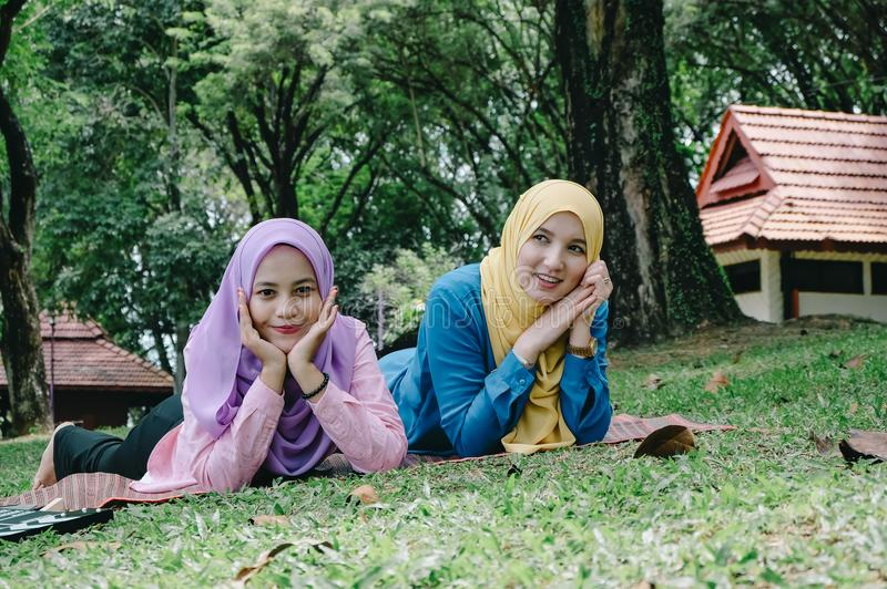 Outdoor lifestyle, friendship and happiness concept. portrait of smile young women at park stock photography
