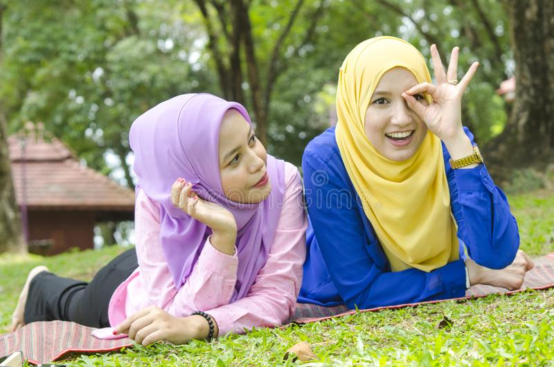 Outdoor lifestyle, friendship and happiness concept. portrait of smile young women at park royalty free stock image