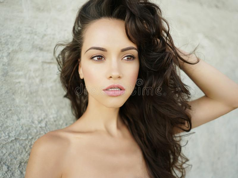 Beautiful brunette woman on the beach stock photography