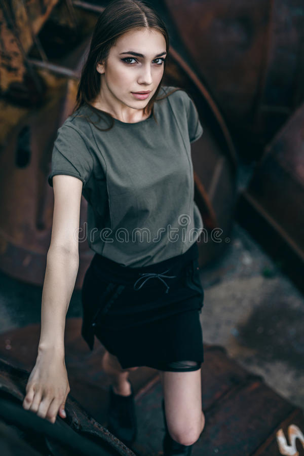 Outdoor lifestyle portrait of pretty young girl, wearing in hipster swag royalty free stock images