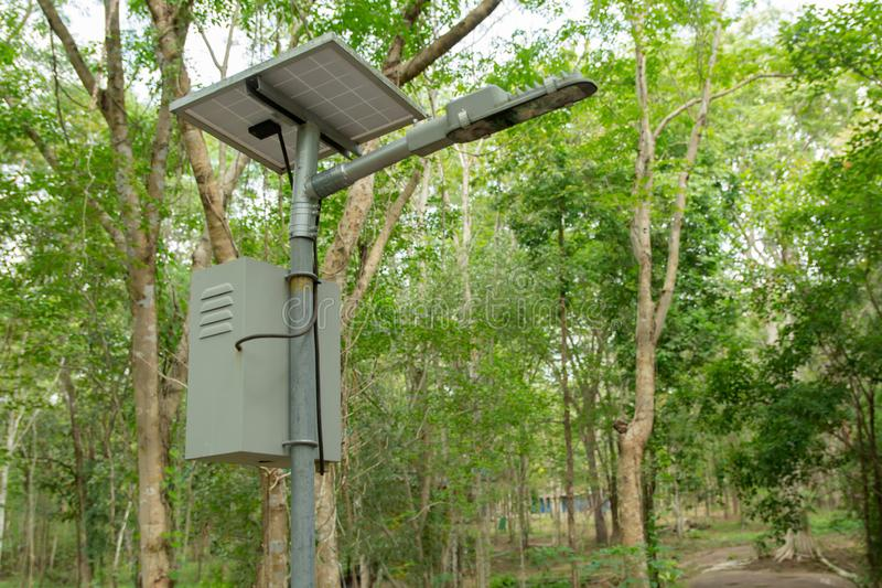 Outdoor lighting pole, street light led pole with small solar cell panel in public park.  stock photo