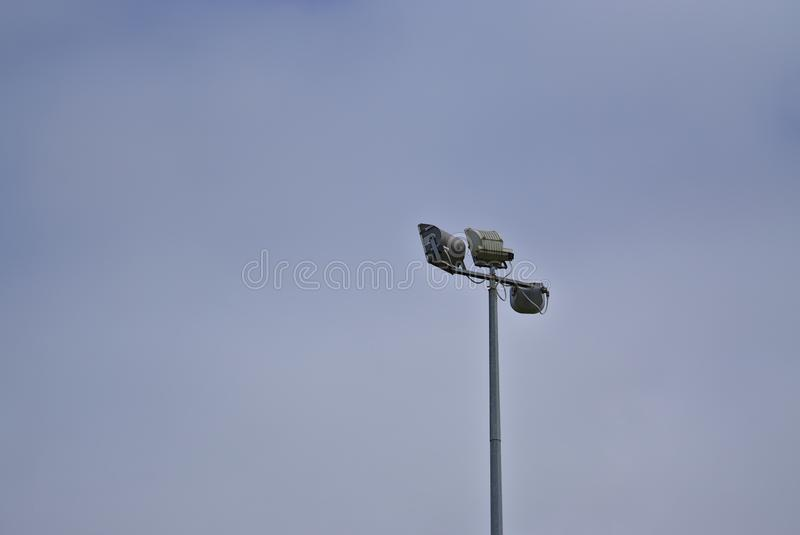 Outdoor lighting for sports fields. Distant view of outdoor lighting for sports fields with light blue sky background stock photography