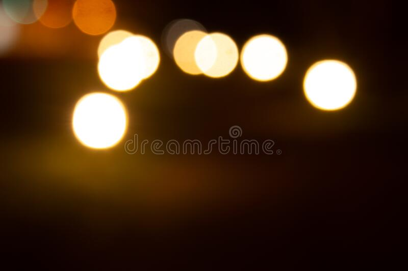 Outdoor lights blurred in night time giving a bokeh effect.  stock photography