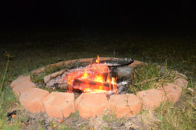 Outdoor living, camp fire,. Burning logs royalty free stock image