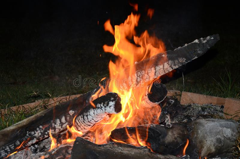 Outdoor living, camp fire,. Burning logs stock photography